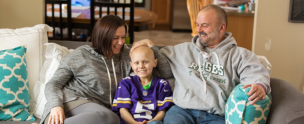 Griffin, Ewing sarcoma survivor, with his parents